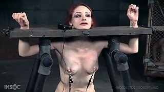 Tears Run Down The Face Of A Redhead In Bondage