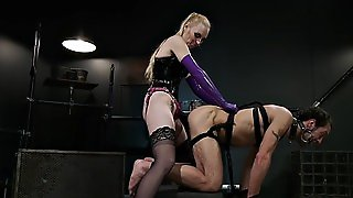 Hooded Mistress Suffers Anal Domination