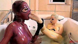 Lucy And Angelica Explore Each Others Feet While The Tub Fills With Water. Lucy Licks Angelicas Toes Through The Latex, And Then Angelica Returns The Favor. Huh, Really Hot!