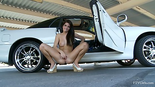 Horny Racquel Rubs Her Pussy Lips At A Parking Lot