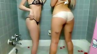 Two Hot Teens Play In The Bathtub On Cam
