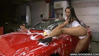 Two Beautiful Brunettes Wash The Car