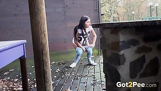 Brunette Spied On As She Takes A Piss