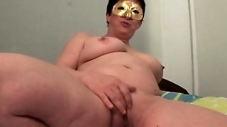 Masked Mature Rubbing Her Shaved Pussy