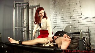 Red Haired Mistress In Red Skirt And White Shirt Tortures Male Slave