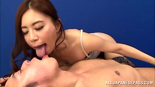 Horny Asian Dame In Fishnet Stockings Awarding Her Guy With Superb Handjob