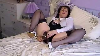 Mature In Nylons Puts Toy In Pussy