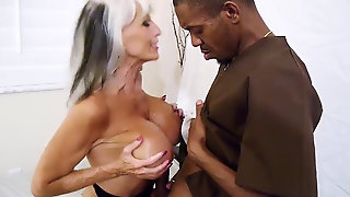 Mature Blond With Big Tits Plays With A Black Cock