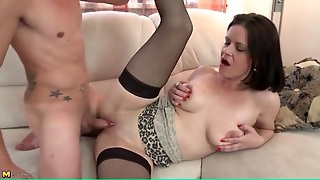 Sexy Mom In Black Stockings Takes Young Dick