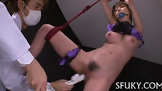 Bound Asian Chick Squirts Into A Bucket With Vibrators