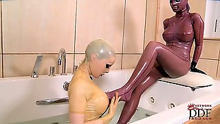 In The World Of The Delightfully Perverse, Some Girls Like To Take A Bath While Theyre Wearing Latex Bodysuits And Masks. Thats What Happens In Our Featured Showcase. Enjoy It.