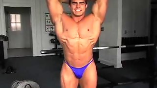 Bodybuilder Flexing His Muscled Body