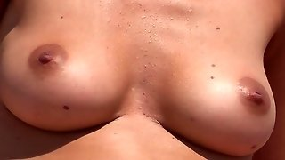 Superb Busty Topless On The Beach
