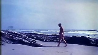 Beautiful Vintage Boy Wanders The Beach In The Nude