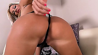 Blonde In A Thong And High Heels Teases The Camera With Her Cunt