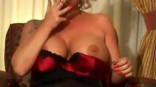 Hot Bigtitted Mature Smoking And Teasing