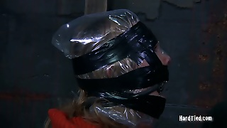 Curvy Blond Hussy Gets Her Head Wrapped With Black And White Tape