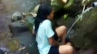 Indo Malay Bathing At A River