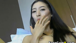 Asian Hottie Squirts With Dildo