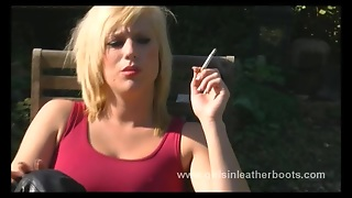 Filthy Blonde Smoking And Showing Pussy In Leather Boots
