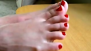 Beautiful Feet With Red Nails