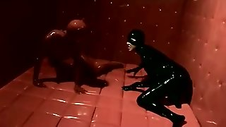 Rubber Catfight In Rubber Cell