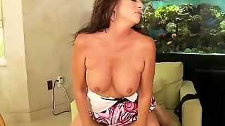 Busty Margo Sullivan Fucks A Young Stud And Takes His Load On Her Face