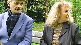A Man Takes A Woman In The Park