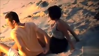 Attractive Doll Enjoys A Man's Cock In The Sand