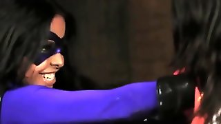 Masked Superheroine Defeats Brunette Opponent And Strapons Her