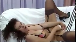 Mature Woman In Lingerie Using A Vibrator