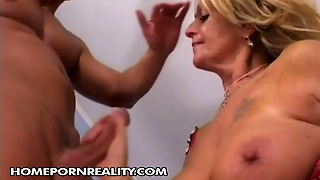Bosomy Blond Mom Fingers Her Pussy While Giving Blowjob To Young Lover