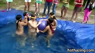 Girls Wrestle In A Homemade Pool Outside And Suck A Dick
