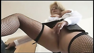 Busty Mature Blonde Secretary Strips