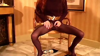 Sexy Redhead Poses In Pantyhose