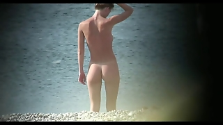 Voyeur On Public Beach