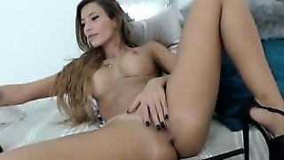 Ashlyn Adorable Brunette Teen Toying Pussy On The Couch