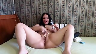 Milf On The Bed Is Playing With A Big Dildo