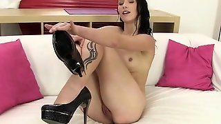 High-Heeled Brunette Peeing In A Bowl