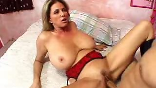 Big Tits And Sexy Boots On Milf Slut