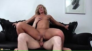 Hot Milf With A Tan Rides His Young Dick