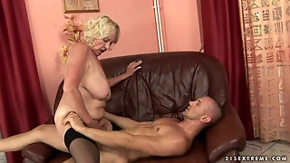Buxom Granny In Black Stockings Rides On Cock Like Crazy
