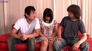 Japanese Doll Massaging Two Oiled Cocks