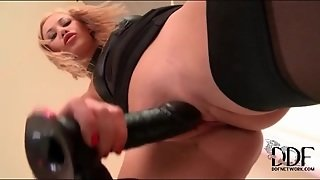 Babe In Sexy Black Dress And Stockings Sucks Toy