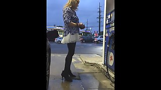 Gassing Up In A White Skirt