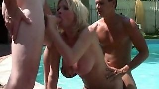 Linda Is Fucked By Two Guy In A Threesome Next To The Pool