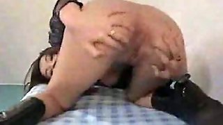 Asian Toying With A Dildo