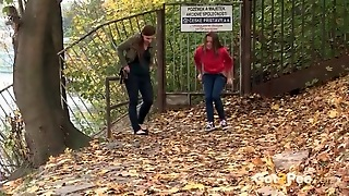 Two Cute Girls Pee In The Leaves Outdoors