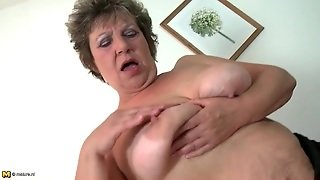 Saggy Tits Granny Masturbates In Stockings