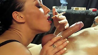 Horny Milf In Black Lingerie Gives Blowjob While Smoking A Cigarette